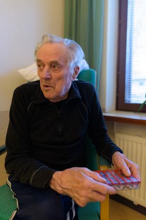 Senior man relaxing at nursing home in Turku, Finland Stock Photo