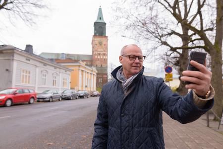 Mature handsome man enjoying life around the city of Turku, Finl