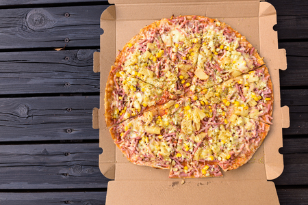 Delicious Hawaiian Pizza Directly Above Shot Stock Photo