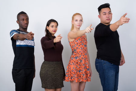 Studio shot of diverse group of multi ethnic friends thinking wh Stock Photo