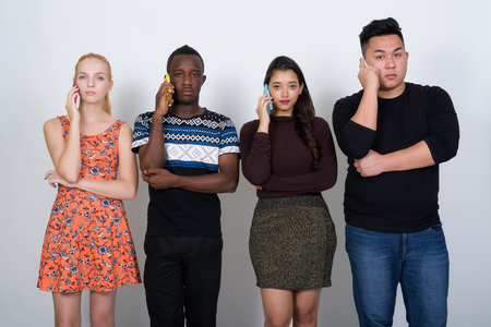 Studio shot of diverse group of multi ethnic friends talking on Stock Photo