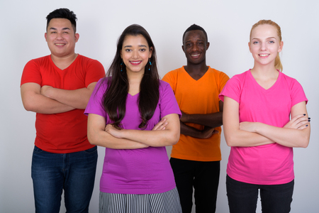 Happy diverse group of multi ethnic friends smiling and standing Stock Photo