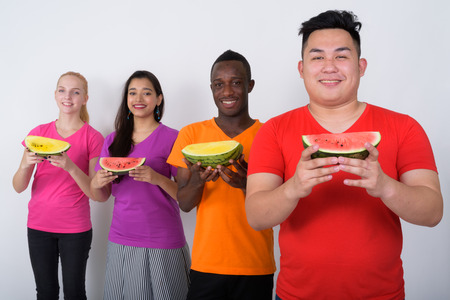 Studio shot of happy young Asian man with diverse group of multi Stock Photo