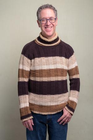 Mature man wearing turtleneck sweater and eyeglasses Stockfoto
