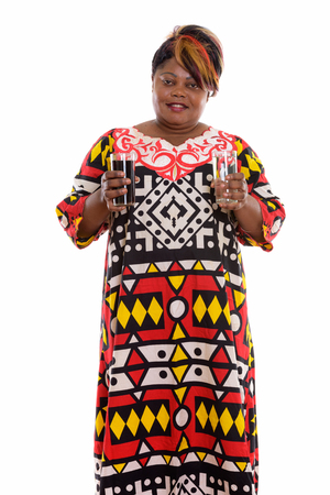 Studio shot of happy fat black African woman smiling and standin Imagens