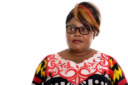 Studio shot of fat black African woman wearing eyeglasses while 写真素材