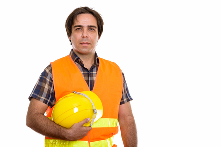 Studio shot of young Persian man construction worker holding saf Stok Fotoğraf