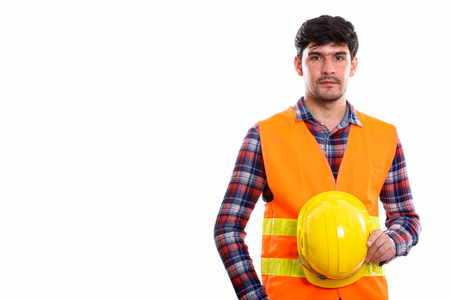 Studio shot of young Persian man construction worker holding saf Stok Fotoğraf - 110818564
