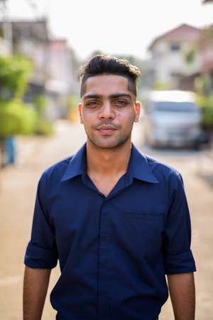 Young Indian businessman in the streets outdoors Stock Photo