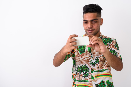 553508ef7 Stock Photo - Young Indian tourist man wearing Hawaiian shirt against white  ba