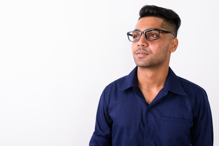 Young Indian businessman wearing eyeglasses against white backgr