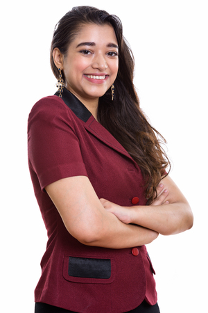 Young happy Indian businesswoman smiling with arms crossed