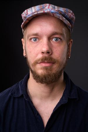 Portrait of man against gray studio background Stok Fotoğraf