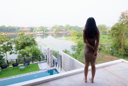 Young beautiful Asian tourist woman exploring in Thailand