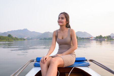 Young beautiful Asian tourist woman traveling with boat in Thailand