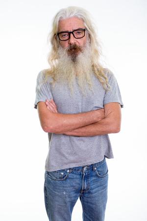 Studio shot of senior bearded man standing while wearing eyeglas Banque d'images