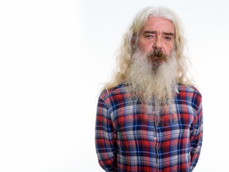 Studio shot of senior bearded man with gray beard and long hair