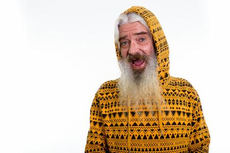 Studio shot of happy senior bearded man smiling while wearing ho