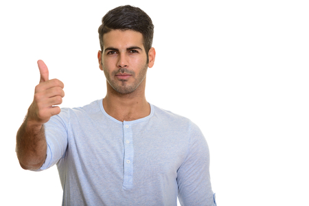 Young handsome Persian man giving thumb up