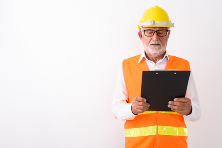 Studio shot of handsome senior bearded man construction worker r Reklamní fotografie
