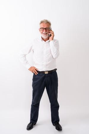 Full body shot of happy senior bearded man smiling and standing