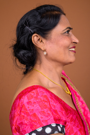 Profile view of happy Indian woman smiling