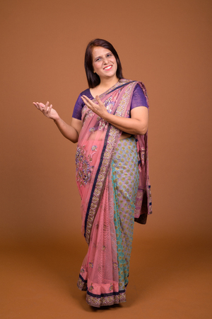 Indian woman wearing Sari Indian traditional clothes and showing copy space
