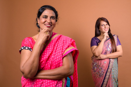Portrait of two mature Indian woman wearing traditional clothes Stock Photo