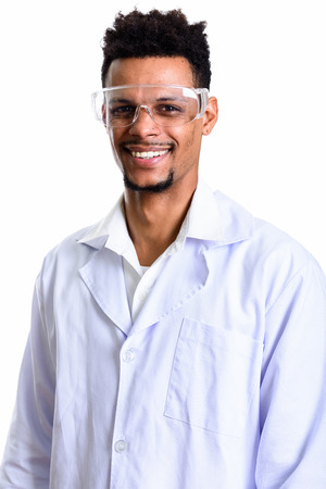 Studio shot of young happy African man doctor smiling Stock Photo