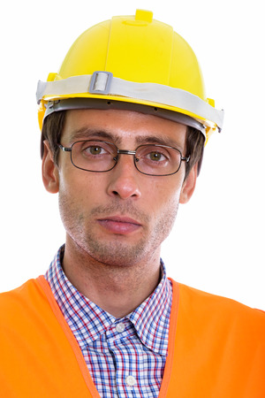 Face of young handsome man construction worker wearing eyeglasses