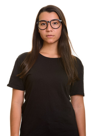 Young beautiful Caucasian woman wearing eyeglasses and looking at camera