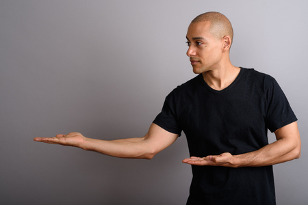 Portrait of handsome bald man showing copy space Stock fotó
