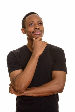 Young handsome African man thinking isolated against white background