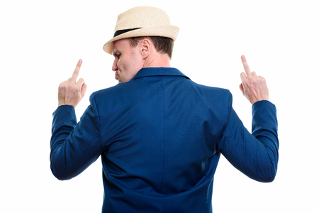 Back view of mature businessman showing his middle finger with b Фото со стока