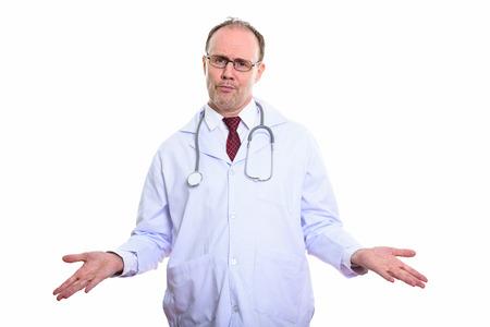 Studio shot of mature man doctor looking confused