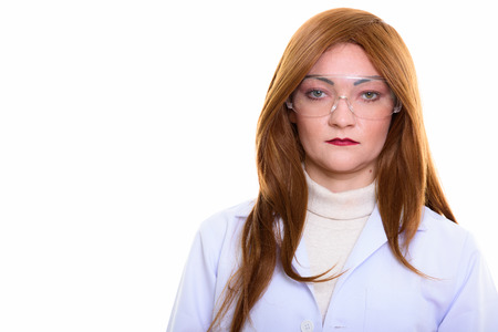 Studio shot of woman doctor wearing protective eyeglasses