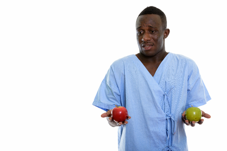 Studio shot of young black African man patient looking confused Stock Photo