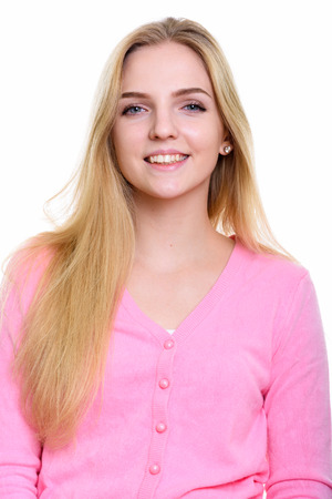 Studio shot of young happy teenage girl smiling