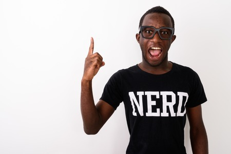 Studio shot of young happy black African geek man with great ide