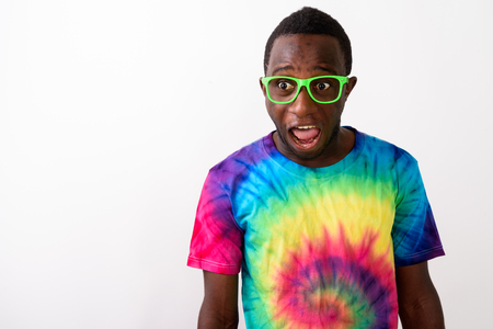 Studio shot of young suprised black African man looking shocked Stockfoto