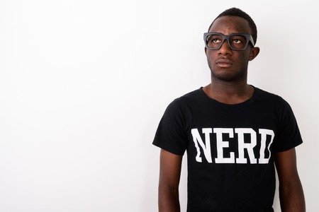 Studio shot of young black African geek man wearing Nerd shirt w