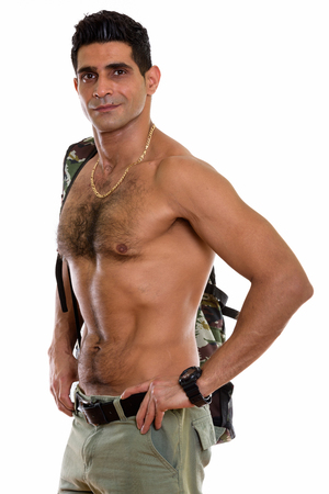 Studio shot of young muscular Persian man posing shirtless Stock fotó