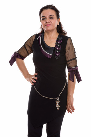 Studio shot of mature Persian woman standing and posing
