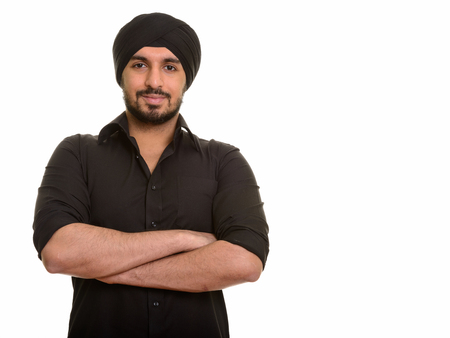 Portrait of young handsome Indian Sikh man Stockfoto