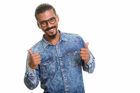 Young happy Indian man giving thumbs up 版權商用圖片