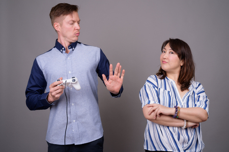 Portrait of multi ethnic diverse couple playing video games