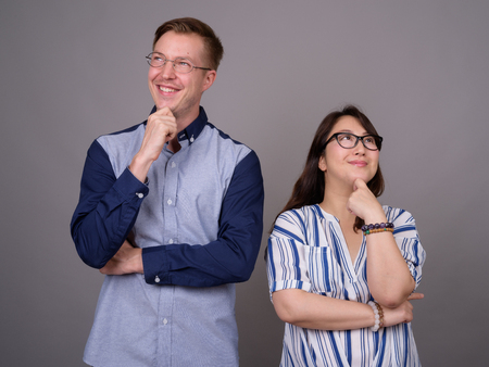 Portrait of happy multi ethnic diverse couple thinking