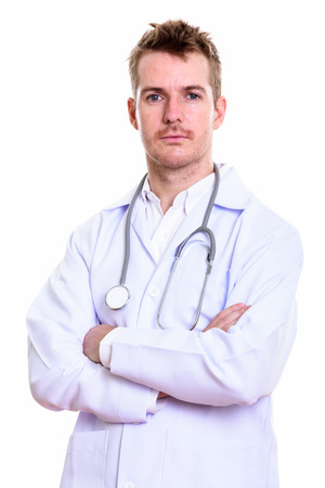 Studio shot of man doctor with arms crossed