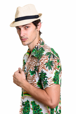 Studio shot of young handsome Brazilian tourist man