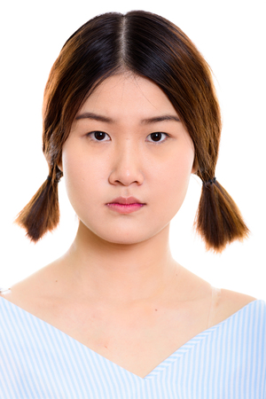 Face of young beautiful Asian woman with pigtails Stock Photo